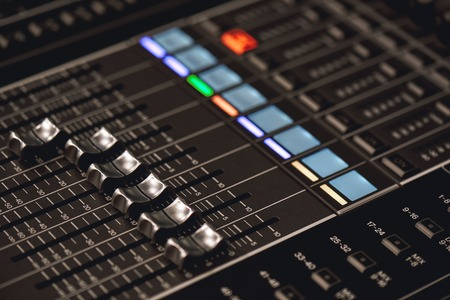 Professional studio equipment for sound mixing. Close-up view of audio control buttons. Media production studio. Music record service