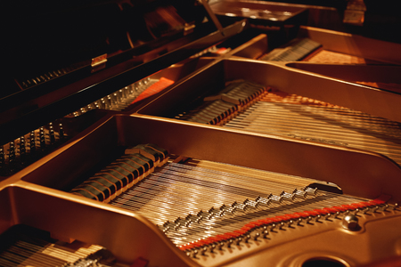 Tuning Your Piano. Close-up view of hammers, strings and pins inside the piano. Musical instruments. Piano mechanism