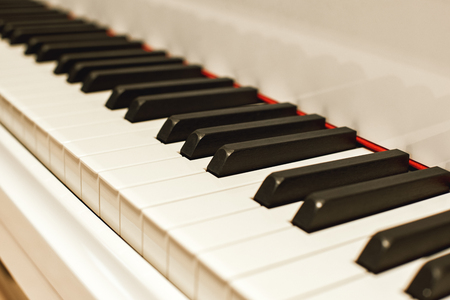 Musical journey. Side view of piano keyboard with black and white keys. Musical instrument