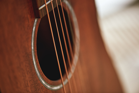 Get to know your instrument. Close up photo of acoustic guitar sound hole. Stockfoto