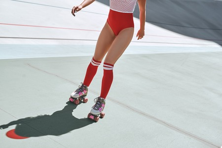 Just roll with it. Close up of girls legs in the skatepark. She is rollerblading