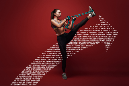 Once you can control your mind, you can control your body. Beautiful sportswoman performs exercises with resistance band over red background. Graphic drawing. Stok Fotoğraf