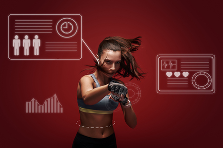 Hustle to gain more muscle. Sportswoman standing concentrated in gym gloves over red background.. Game concept with graphic drawing.
