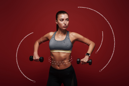 Train hard, win easy. Sportswoman holds dumbbells standing over red background. Graphic drawing.