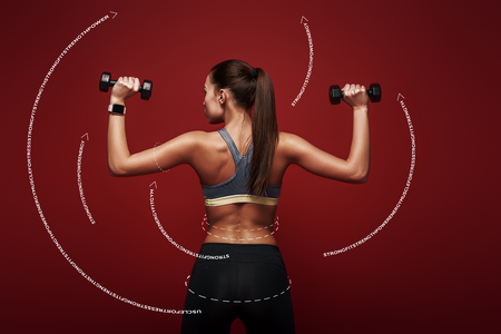 Determined to win. Sportswoman holds dumbbells standing over red background. Graphic drawing. Stock Photo