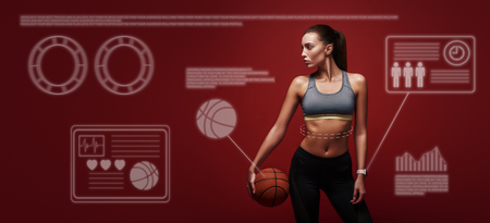 Do what you like. Sportswoman is training with ball standing over red background. Game concept. Stok Fotoğraf