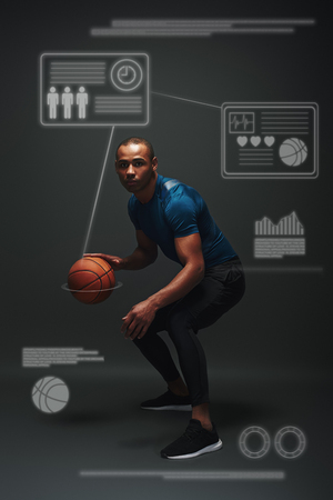 Nothing but success. Young basketball player standing over dark background. Game concept with graphic drawing.