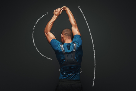 Hard work will solve your problems. Sportsman is stretching standing over dark background. Graphic drawing. Banco de Imagens