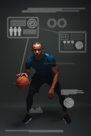 Victory is the goal. Young basketball player standing over dark background. Game concept with graphic drawing. Imagens
