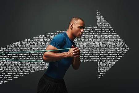 Pushing hard. Sportsman working out with resistance band over dark background. Graphic drawing. Stock Photo