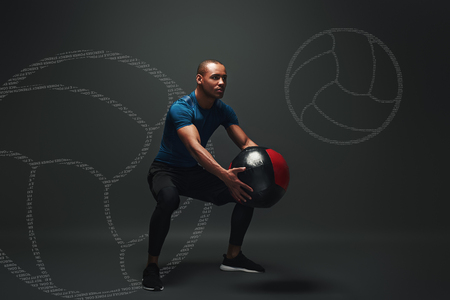 Test yourself. Young sportsman standing over dark background with a ball in his hands. Game concept with graphic drawing. Banco de Imagens