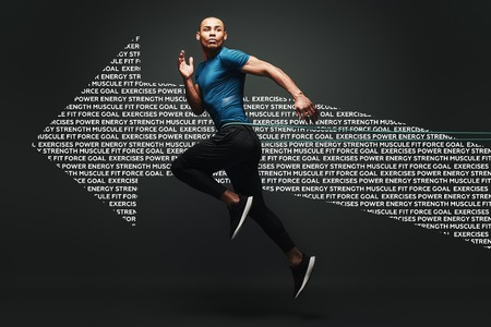 I can do it. Sportsman jumping with resistance band over dark background, looking away. Graphic drawing. Standard-Bild - 119693636