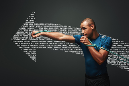 Full of energy. Sportsman working out with resistance band over dark background. Graphic drawing.