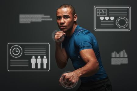 Take a chance. Muscular boxer is ready to fight. Young sportsman standing over dark background. Game concept with graphic drawing. Stock Photo