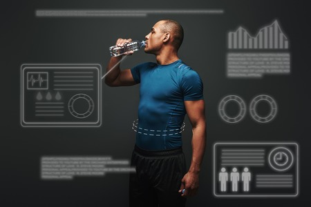 Hydrating. Muscular sportsman drinking water after training. Game concept with graphic drawing.