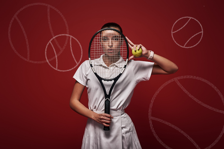Young tennis player in white polo shirt and skirt standing over red background with a racket and a ball. Graphic drawing. Stock Photo - 120896565