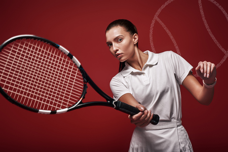 Young tennis player in white polo shirt and skirt standing over red background with a racket and a ball. Graphic drawing. Standard-Bild - 120896569