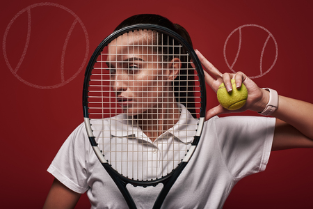 Young tennis player in white polo shirt and skirt standing over red background with a racket and a ball. Graphic drawing.