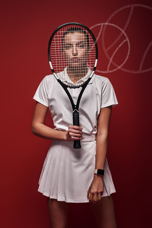 All it takes is all you ve got Young tennis player standing over red background with a racket and a ball. Graphic drawing. Stock Photo