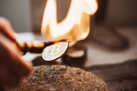Rebirth of cryptocurrency. Close-up photo of hot new bitcoin coin made in workshop