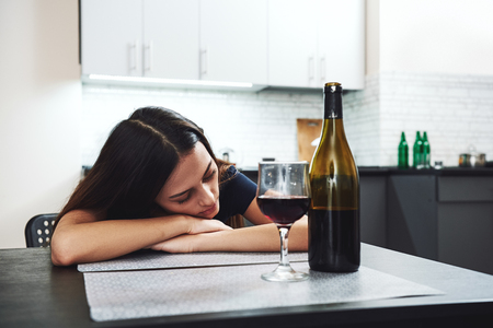 What is addiction, really? It is a sign, a signal, a symptom of distress. Young addicted, depressed woman sleeping in the kitchen