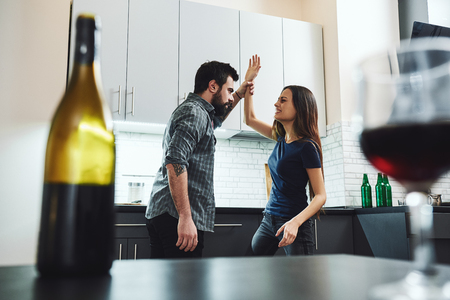 Everything I had I gave to alcohol. Family of alcoholics. Couple having an argument in the kitchen. Social problems concept Stock Photo - 118554467