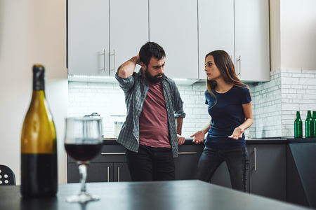 I'm not telling you it is going to be easy, I'm telling you it's going to be worth it. Family of alcoholics. Couple having an argument in the kitchen Stock Photo - 118554582