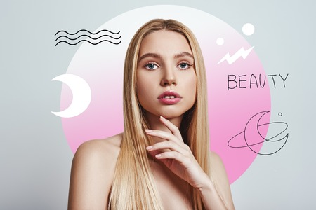 Sensitive care for your skin. Gorgeous young woman with long blond hair touching her skin and looking at camera against abstract pink circle and hand drawn illustrations. Skincare concept. Women beauty