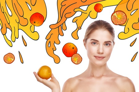 Foods that make you beautiful. Portrait of pretty and healthy woman holding an orange while standing against white background with hand drawn orange splashes and fruits on it