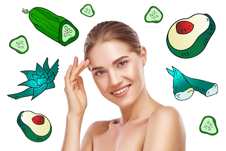 Natural face mask. Portrait of happy young woman with perfect skin looking at camera while standing against background with colorful illustrations of face mask ingredients on it. Skin care