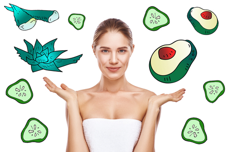 I choose natural ingredients! Portrait of happy young woman with perfect skin showing at aloe vera and avocado illustrations drawn on white background. Skin care Фото со стока