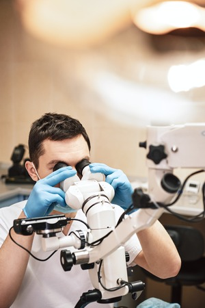 Upscale dental care. Professional modern microscope equipment at dental office in use. Stomatology concept