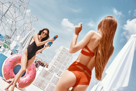 Wet n Wild! Young girls having fun at the rooftop pool party