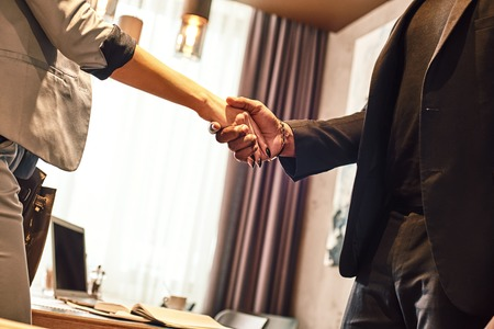 Close up view of two business people shaking hands. Business communication concept