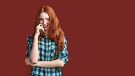 Looking at you. Modern playful teenage girl touching lips and looking at the camera Stock Photo