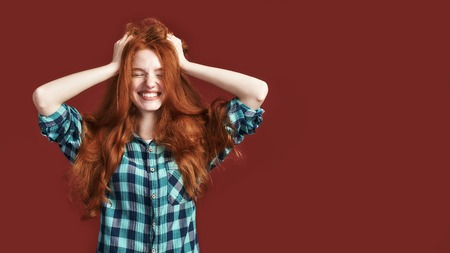 Happiness is my choice Modern playful teenage girl touching her hair