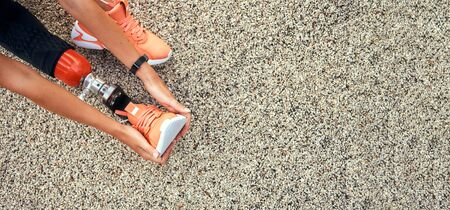 Top view of woman stretching her prosthetic leg. Web banner Stockfoto