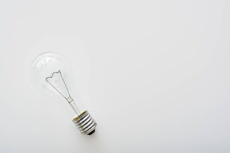 Light bulb, isolated. Realistic photo image. Typical tungsten light bulb in off-state Banco de Imagens