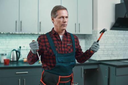 Fair and honest handyman. Man solves household problems Stockfoto
