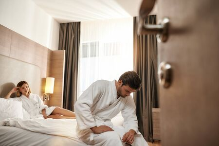 Im not sure... Couple relaxing in hotel room wearing robes