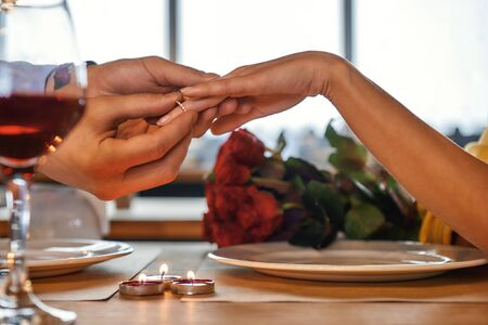 Will you marry me Young romantic couple is celebrating anniversary in restaurant