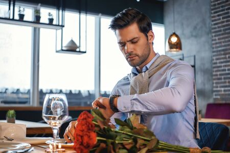 Ready to meet you. Romantic man is waiting for his date in restaurant