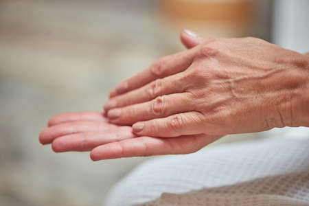Beautiful manicured middle aged woman hands