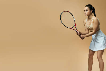 Website header of Attractive young woman playing tennis in studio