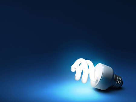 electricity supply: Compact Fluorescent Bulb - Resting on blue backdrop