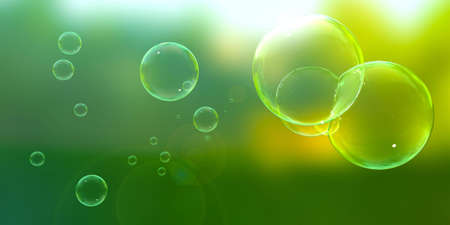 Soap bubbles floating about on a sunny afternoon. Stock Photo