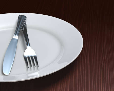 Glossy plate with cutlery on rich, dark woodgrain surface.