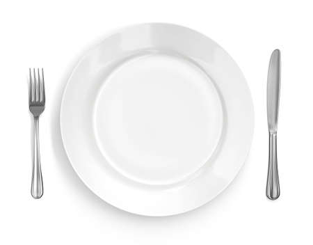 Place setting with high-gloss plate, knife &amp, fork. Isolated on white