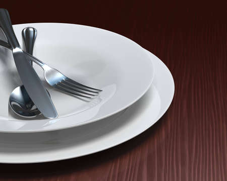 Plate and soup bowl with cutlery on rich, dark woodgrain surface.