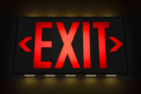 way out: Emergency Exit Sign in the Dark Stock Photo